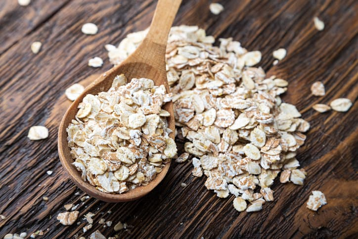 oats in spoon on wooden table