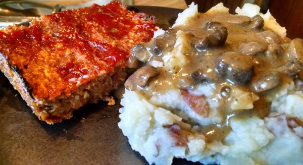 vegan meat loaf made from with bulgur wheat with a side of mashed potatoes