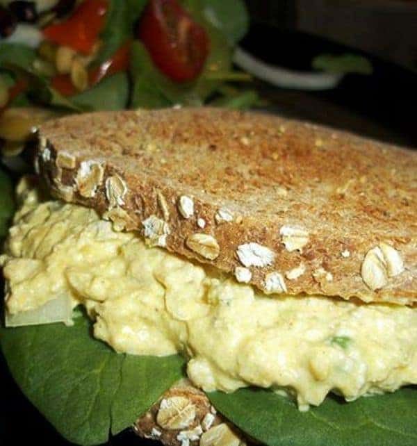 Vegan Egg Salad sandwich with fresh spinach leaves