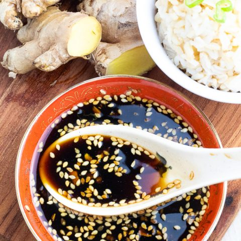 sweet ginger sauce in asian bowl with soup spoon