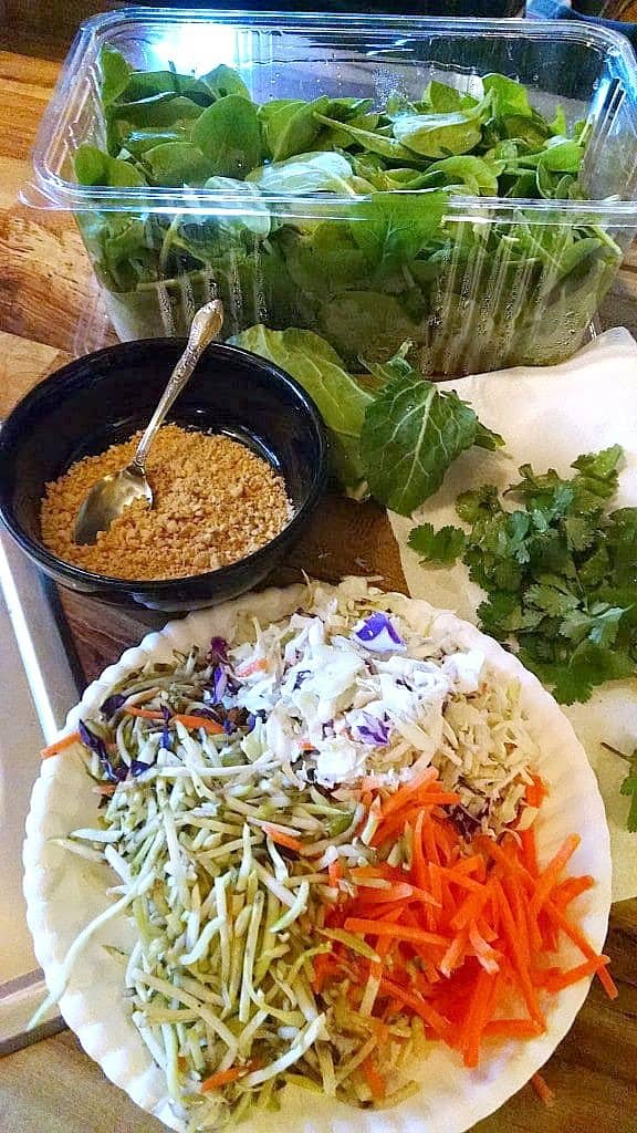 Collards greens, spinach, broccoli slaw, cilantro, shredded carrots, peanuts for spring rolls.