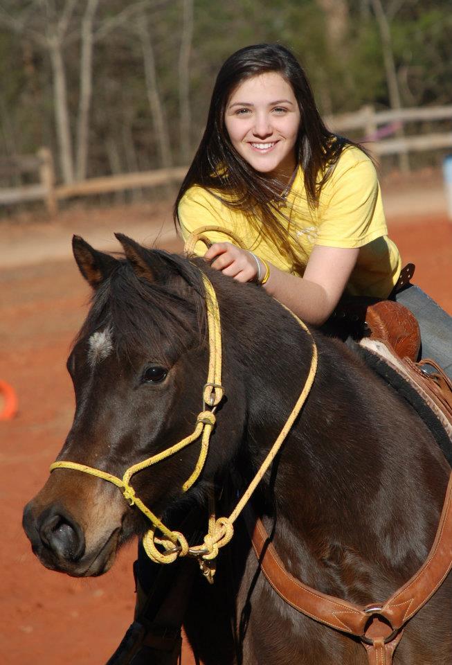 La'el on horse.