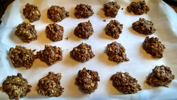 vegan oatmeal raisin cookies on parchment paper