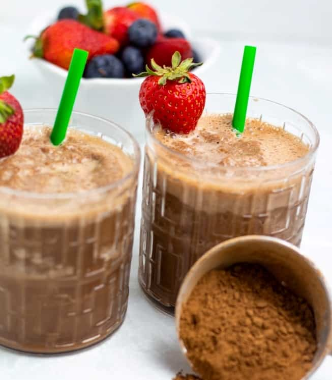 vegan chocolate banana smoothie in two glasses with straw