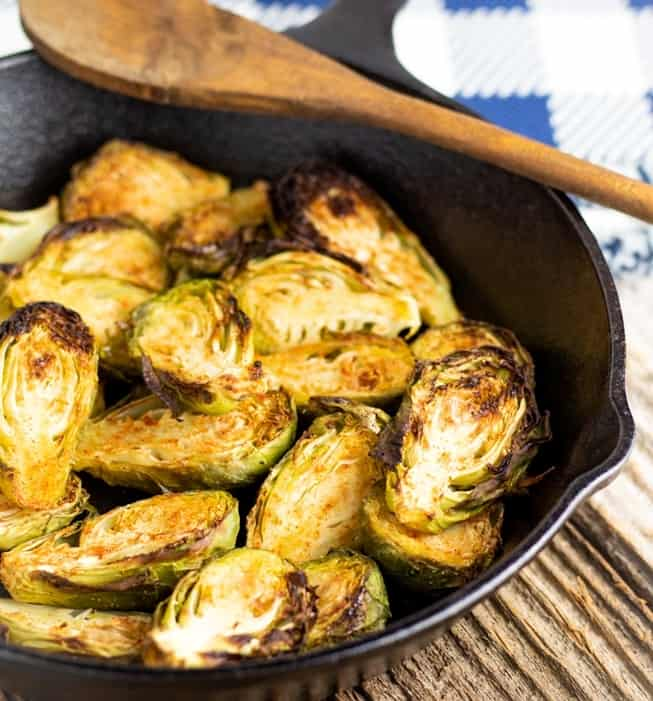 brussels sprouts slice in half in cast iron pan