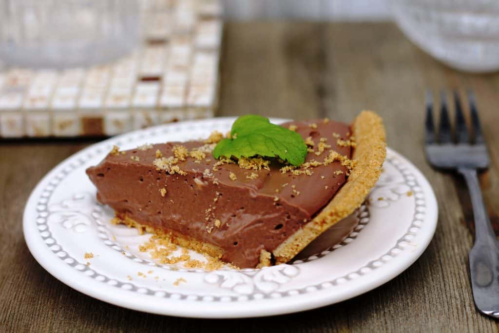 No Bake Vegan Chocolate pie on white plate with mint leaf.