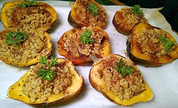 stuffed acorn squash on baking sheet