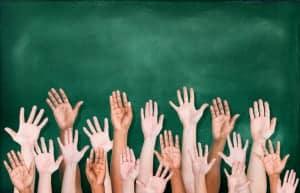 classroom hands raised