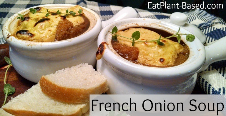 vegan french onion soup in white crock bowls.