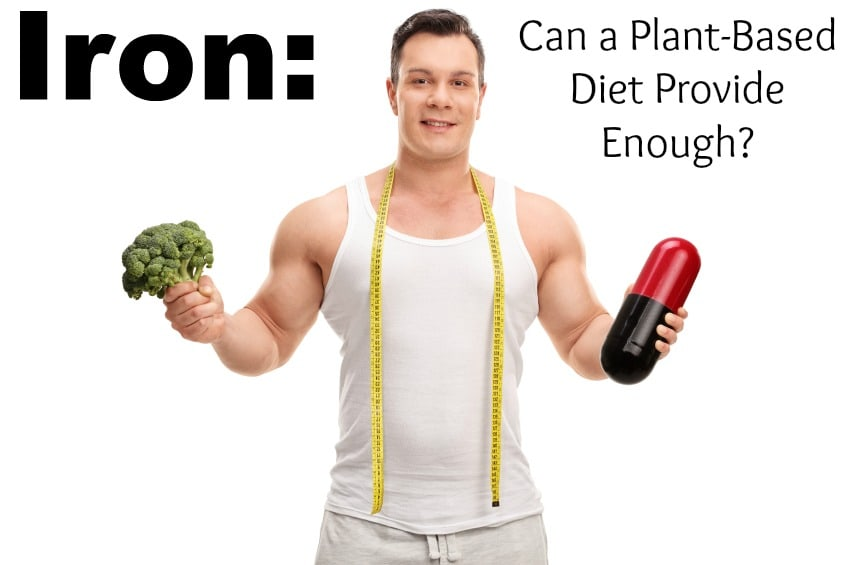 Young man holding a piece of broccoli in one hand and a large diet pill in the other isolated on white background