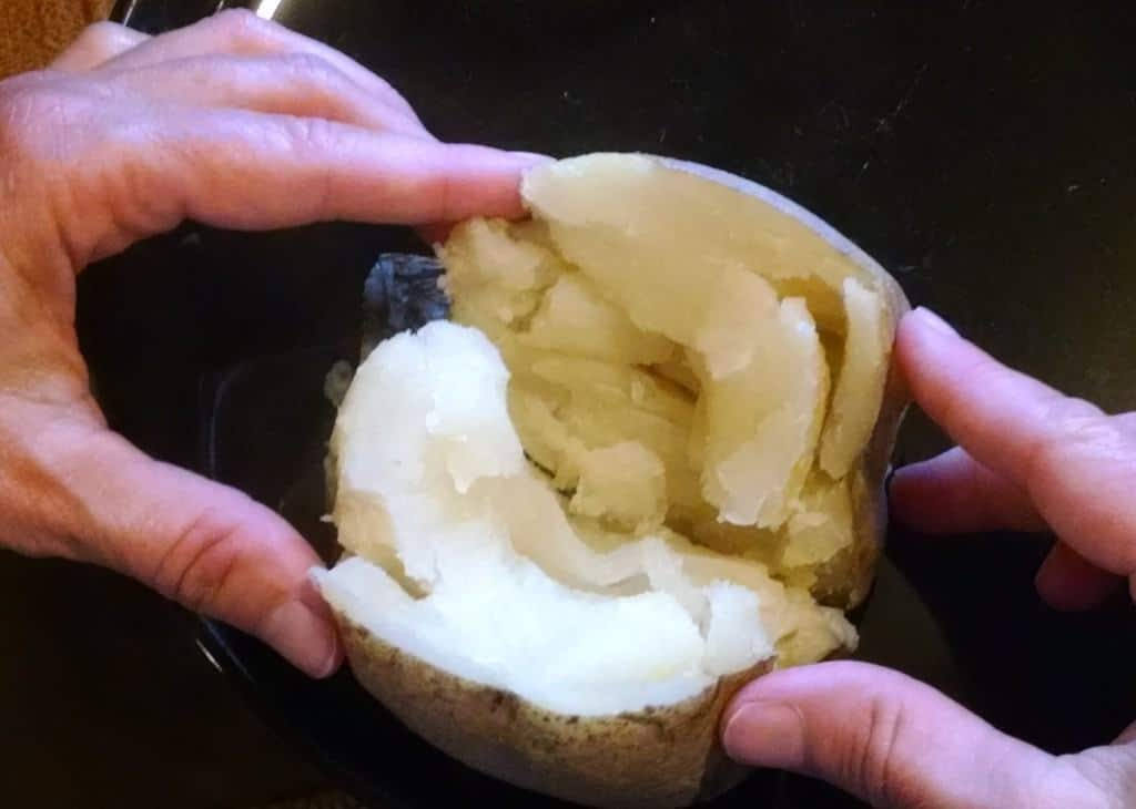 baked potato being opened