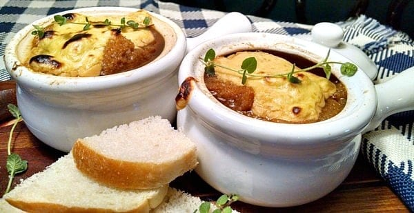 Vegan French Onion Soup in white bowls