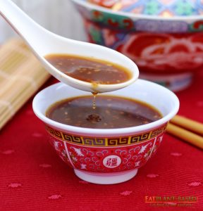 stir fry sauce with drip in bowl