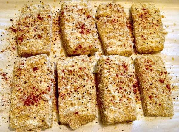 Breaded tofu ready to bake.