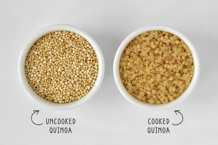 Cooked and uncooked quinoa in bowl on white background