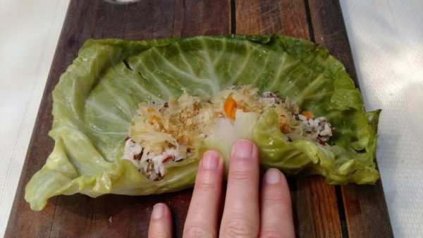 rolling and folding stuffed cabbage rolls