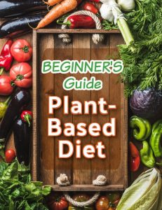 wooden board surrounded by veggies that says plant based beginners guide