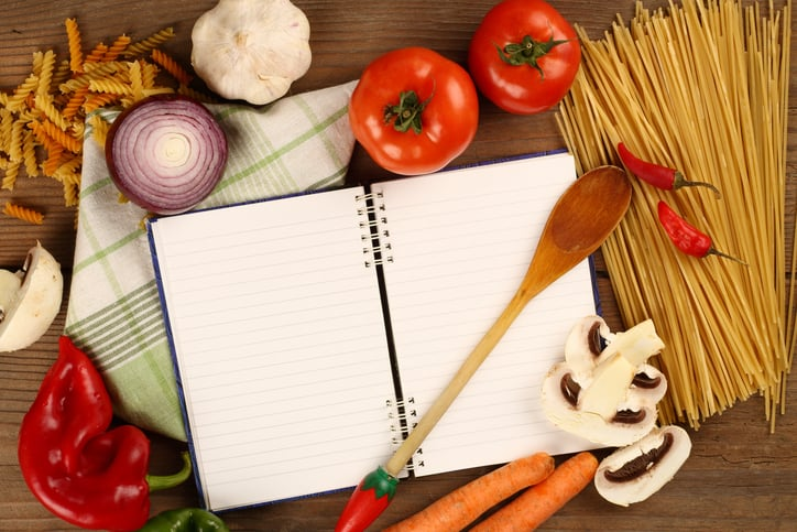 Fresh vegetables and blank recipe book