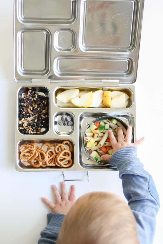 baby eating from lunch box