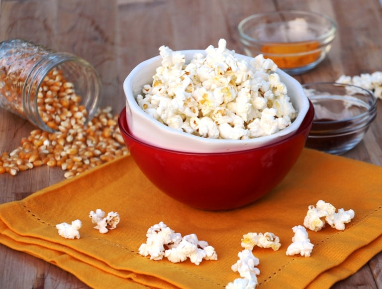 Healthy popcorn toppings. popcorn in bowl.
