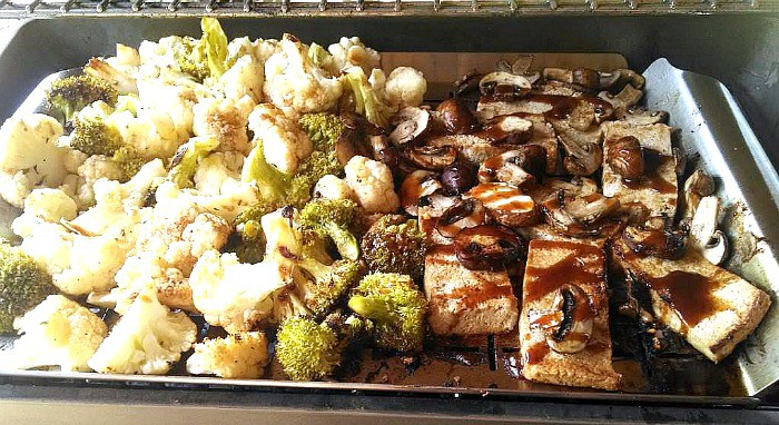Tofu Steaks with broccoli and cauliflower on grill
