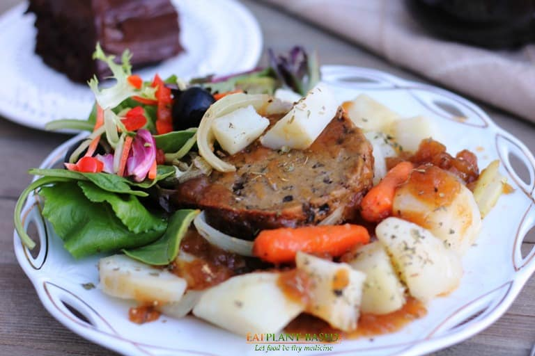 Mushroom roast served with potatoes, carrots, and onions.