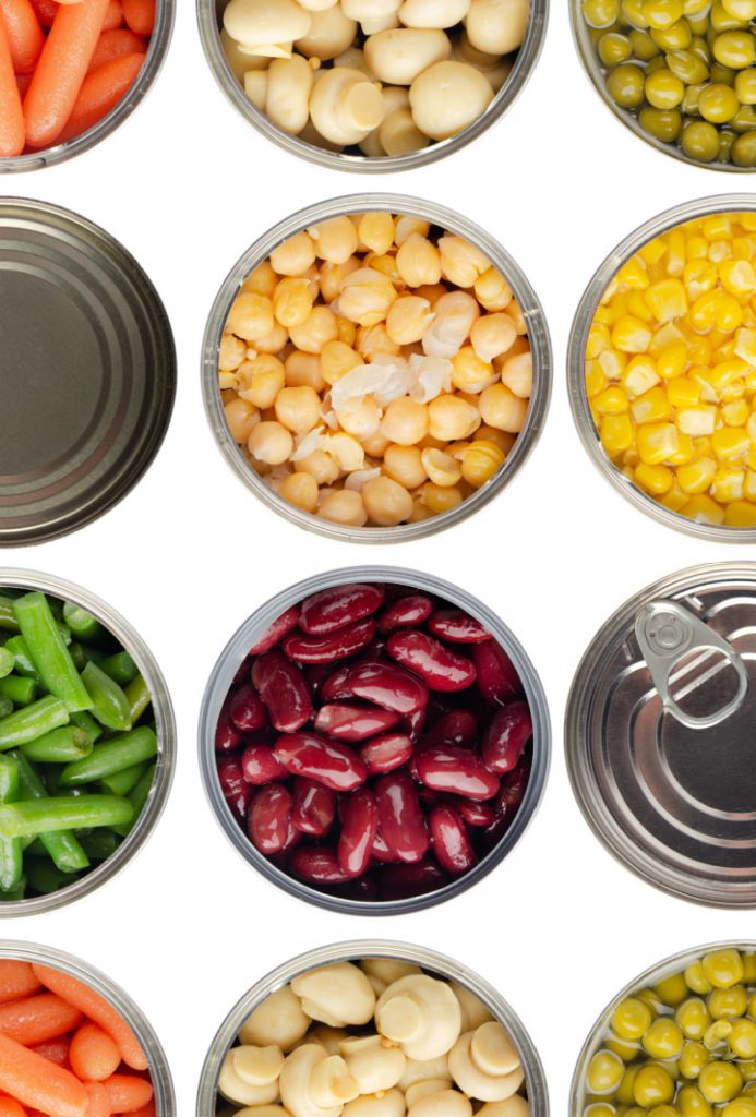 Seamless food background made of opened canned chickpeas, green sprouts, carrots, corn, peas, beans and mushrooms on white background