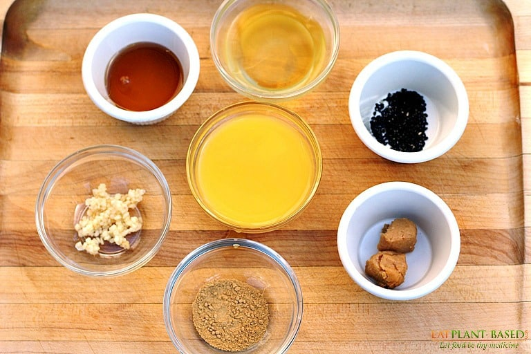 ginger miso dressing ingredients on wooden board