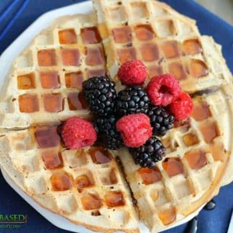 vegan waffles with berries on plate with fork