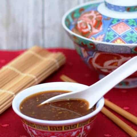 stir fry sauce recipe in asianbowl with spoon on red mat