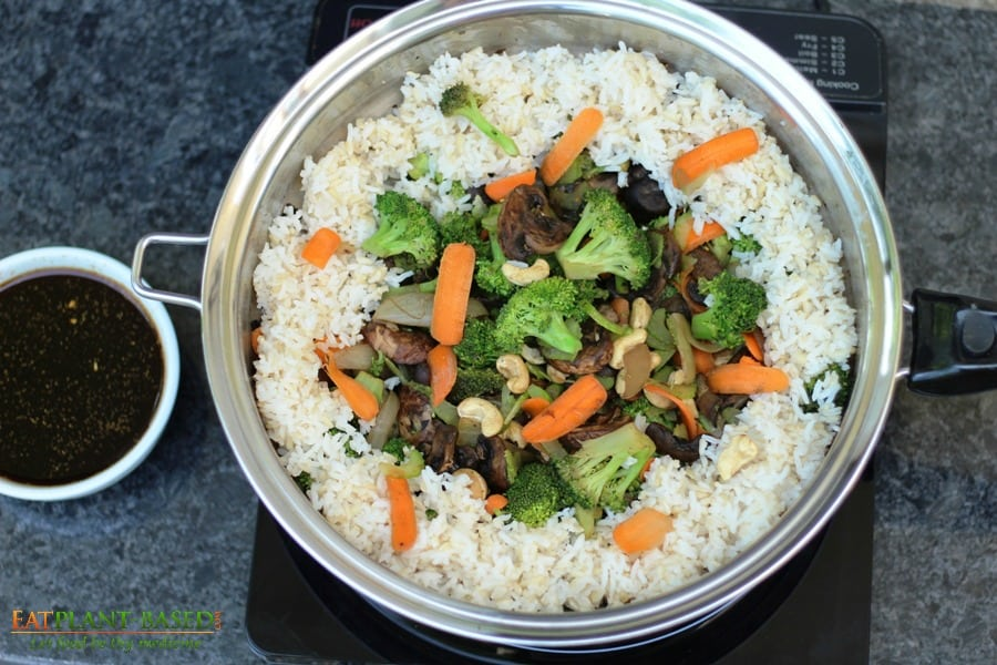 stir fry veggies in pan with rice