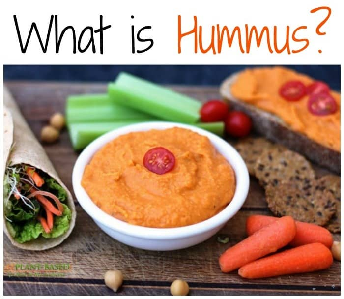 hummus surrounded by veggies and bread