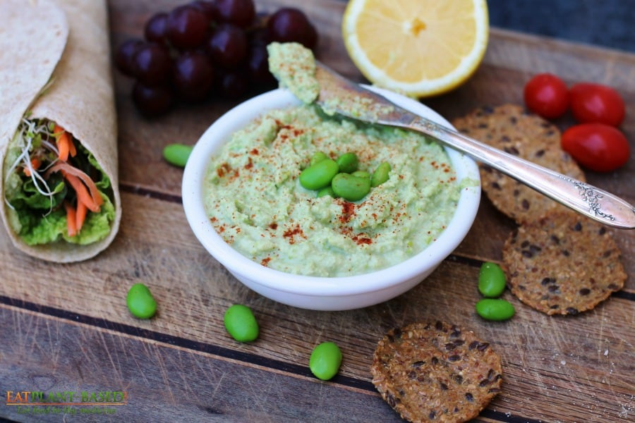 edamame hummus on cutting board ready to spread on hummus sandwich