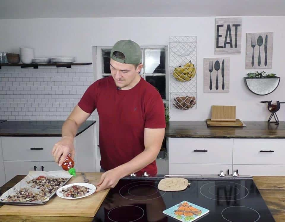 plant based gabriel cooking in kitchen