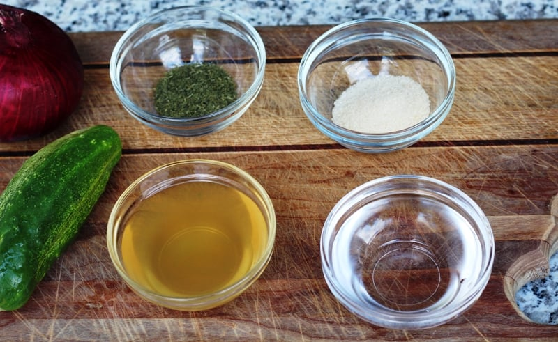 dry dill, sugar, vinegar, and water on cutting board
