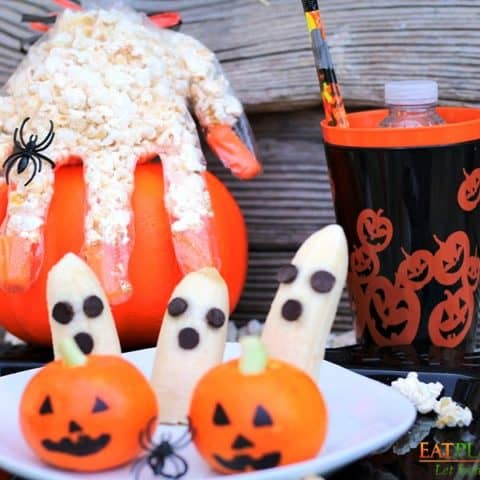 halloween popcorn hands, banana ghosts, and tangerine pumpkins