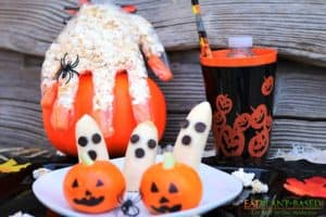 Halloween popcorn hands, banana ghost, tangerine jack o lanterns
