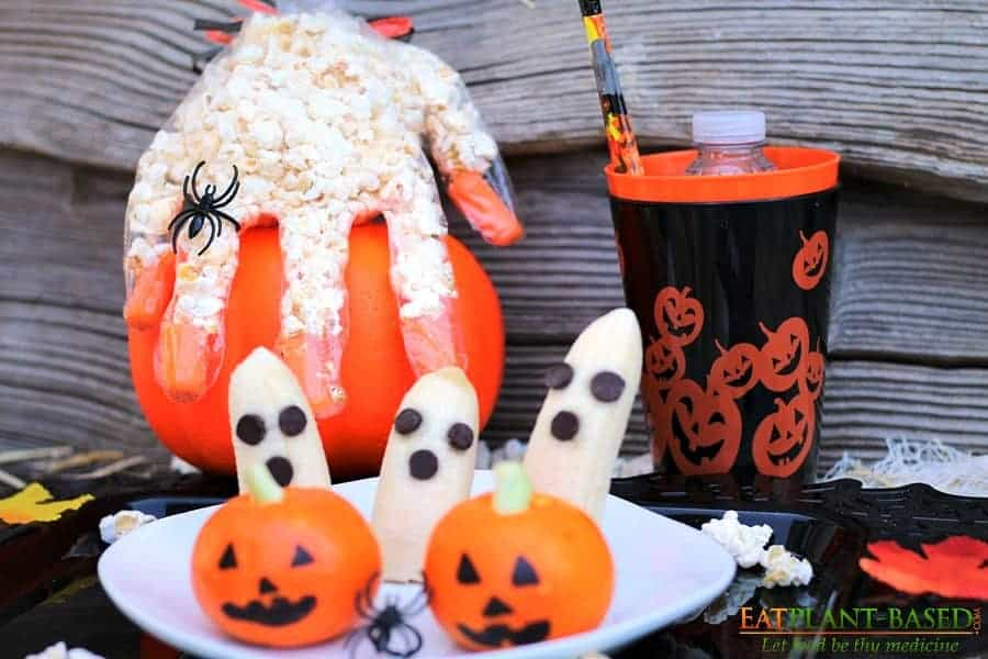 halloween treats popcorn hands and banana ghosts