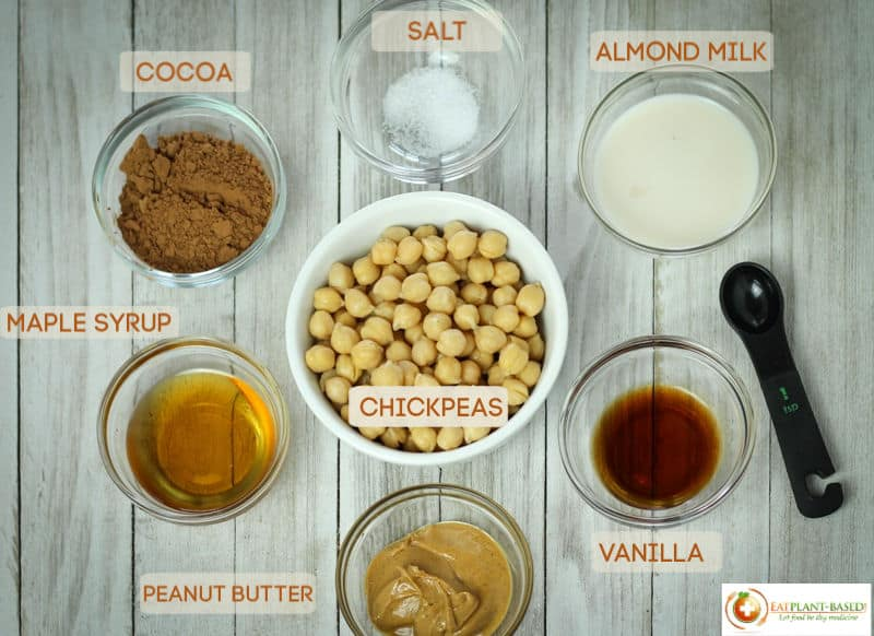 ingredients for chocolate hummus on wooden table