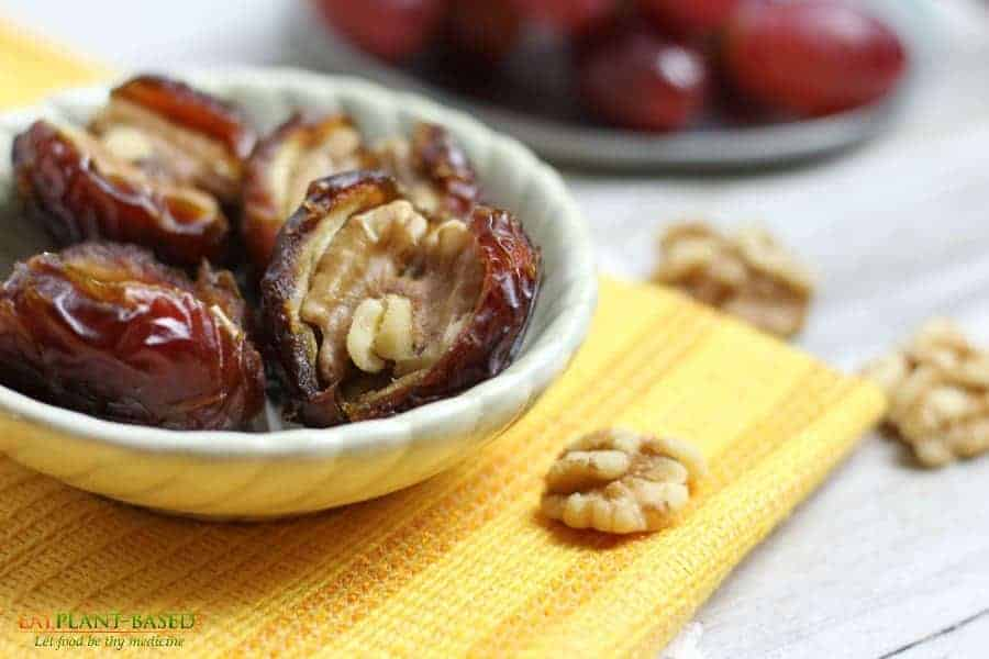Stuffed Dates in white bowl with yellow napkin