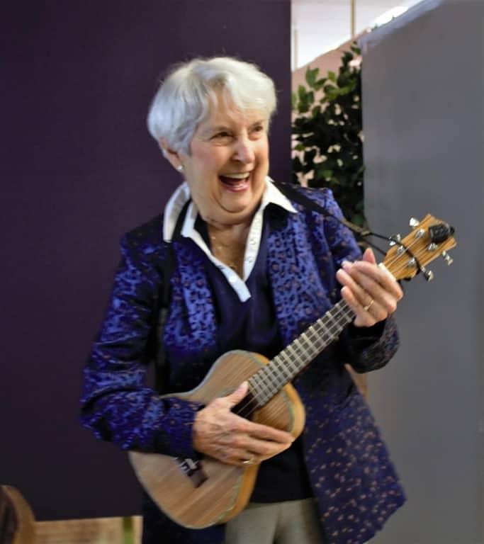 Millie a senior citizen playing guitar