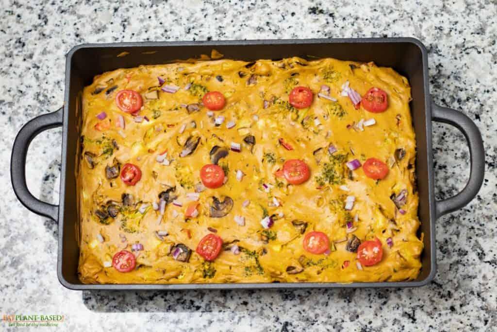 vegan quiche in retangle cast iron pan on countertop