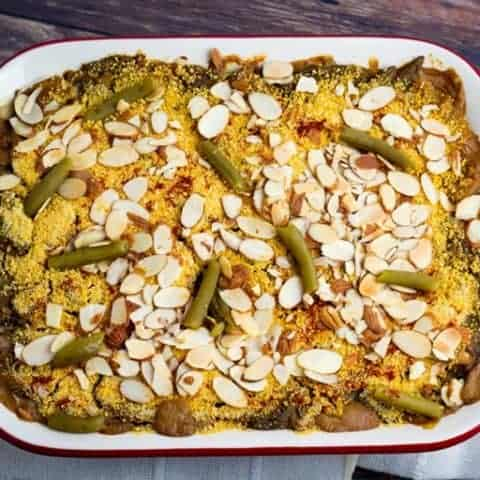 vegan green bean casserole in cuisinart red pan on wooden table