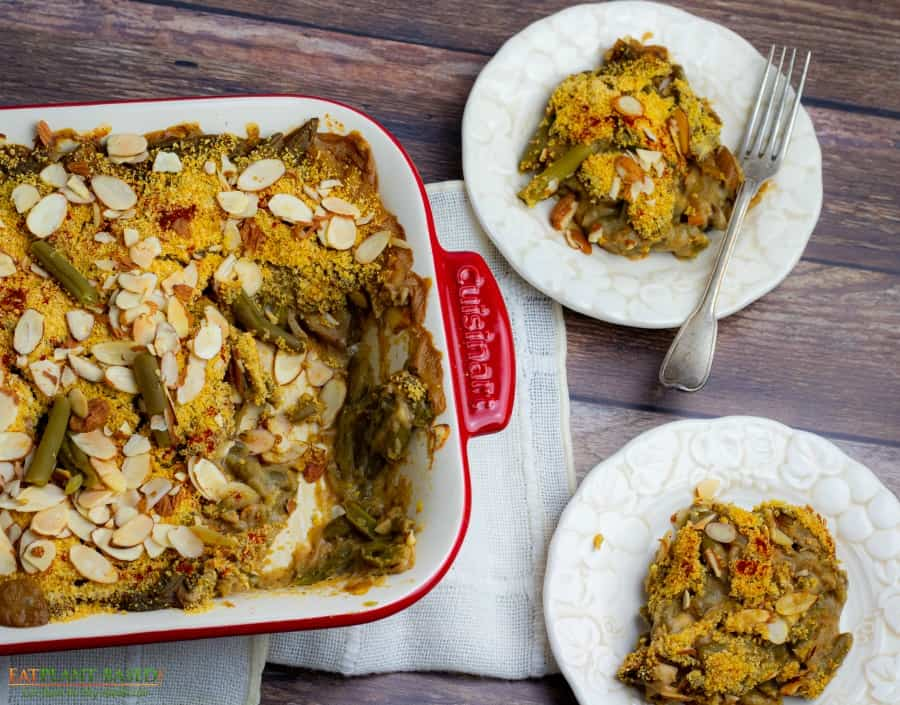 green bean casserole in pan with 2 dishes on side