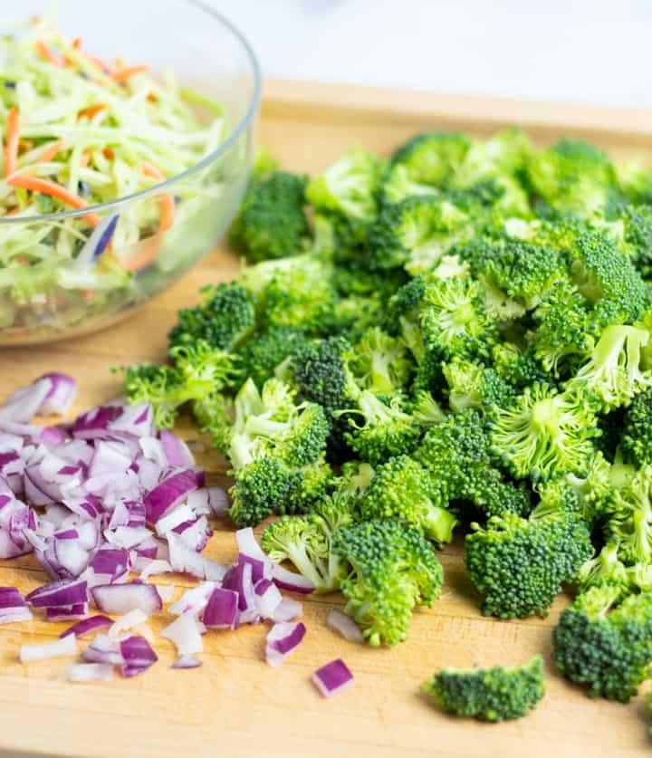 diced broccoli and purple onion on cutting board