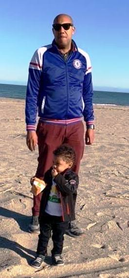 Sam Tyler after weight loss photo on beach with his son