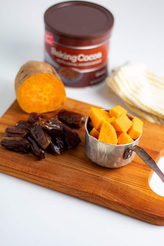 ingredients for sugar free chocolate icing on counter sweet potatoes dates