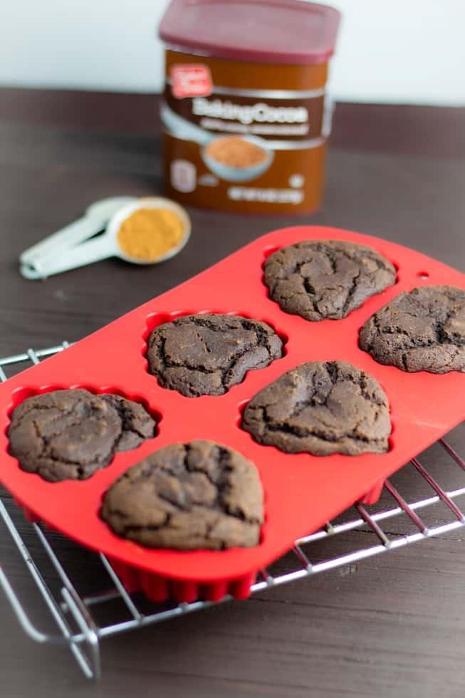 vegan chocolate valentine dessert in red baking pan on cooling rack