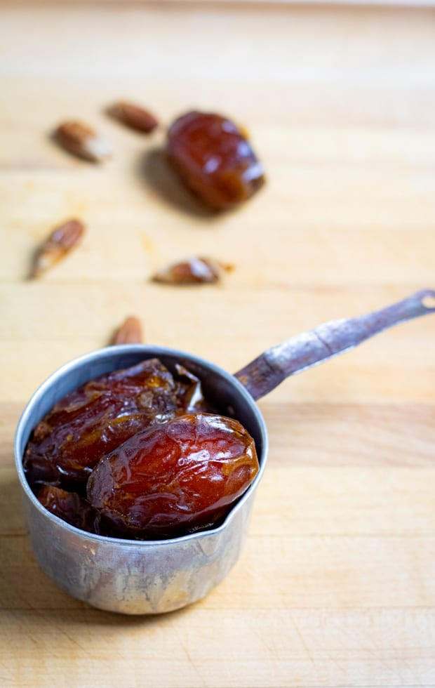 medjool dates in old tin measuring cup