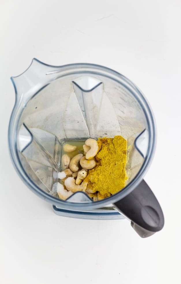 cashew cheese ingredients in vitamix blender on white background
